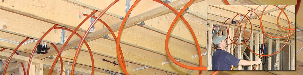 Installing radiant heating tubing in floor joists