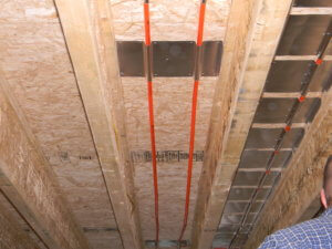 Installed aluminum heat transfer plate for radiant floor heat.