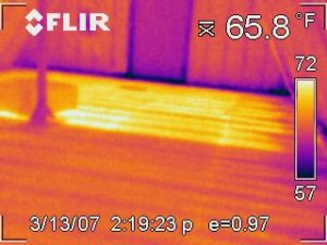 Photo showing difference in heat output for an area with and without heat transfer plates.