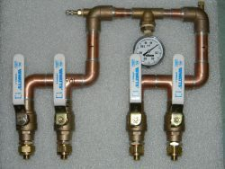 Radiant heating tubing manifold for wall mounting.